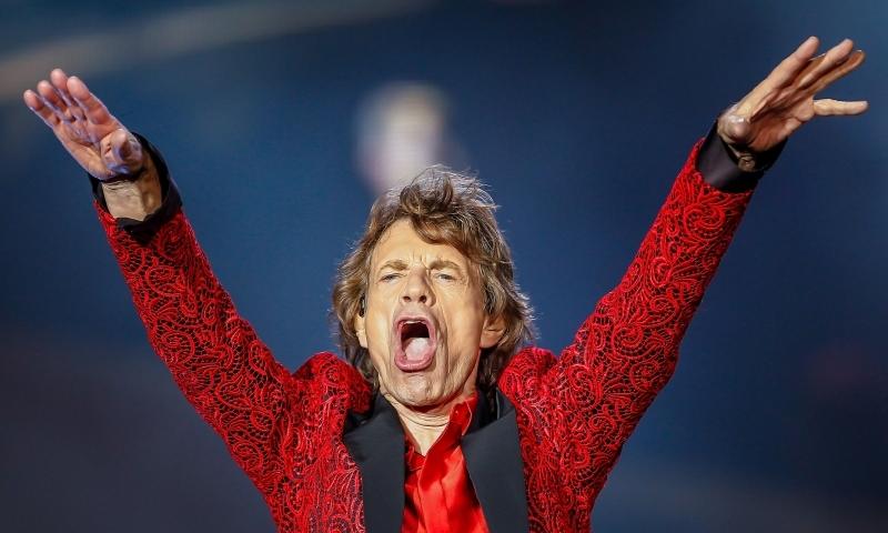 Qual a relação entre Negócios e o Sucesso de Rolling Stones?